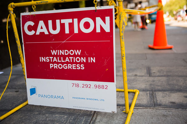 sidewalk sign, NYC residential tower window installation